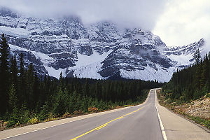 Snowy Mountains Behind Road