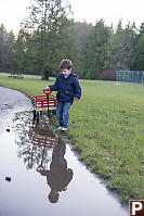 James Trying To Walk Around Puddle