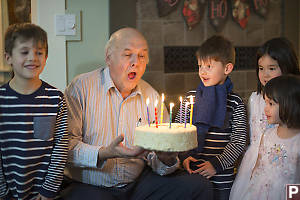 Grandpa Blowing Out His Candles