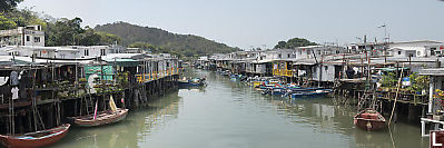 Stilt Houses With Boats From Bridge