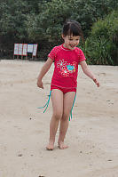 Claira Walking On Beach