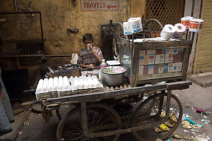 Boy Selling At Cart
