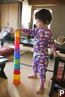 Claira Stacking Cups On Tatami Mats