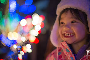Claira Smiling With Bokeh Lights
