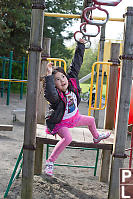 Nara Swinging On Monkey Bars