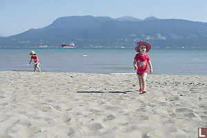 Walking On The Sand At Spanish Banks