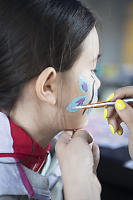 Nara Getting Butterfly Face Paint With Sparkles