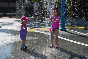 Two Girls With Spraying Water