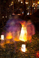 Ghostly Kids Standing Around Lanterns