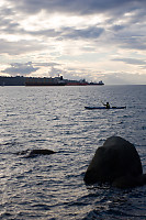 Kayaker Going By Three Ships