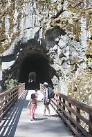 Walking Over Trestle Into Cave