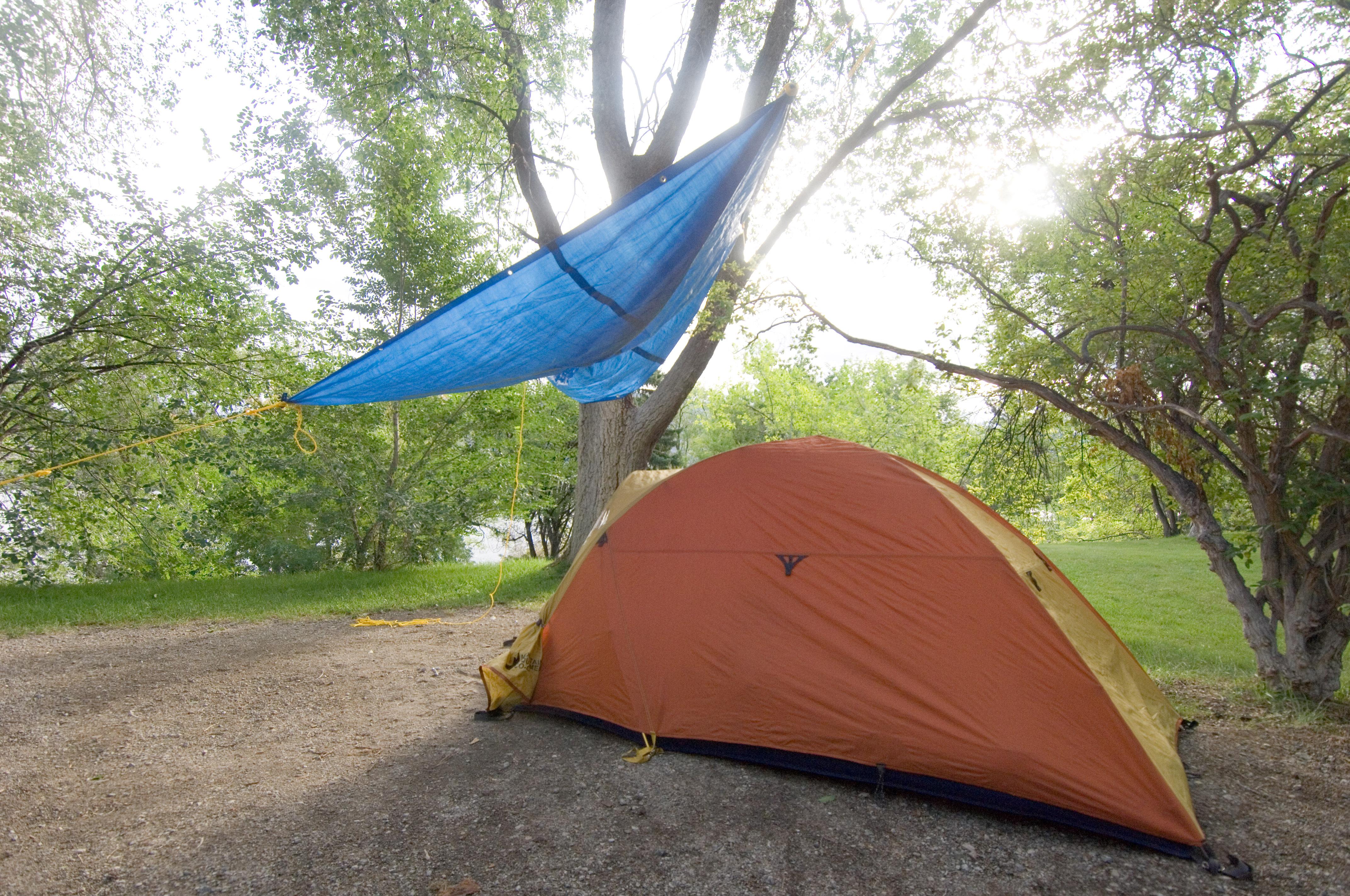 Tent With Tarp Over Entrance & Search John Harvey Photo...