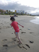Claira Running Up The Beach