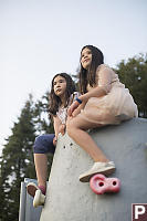 Kids On Top Of Climbing Wall